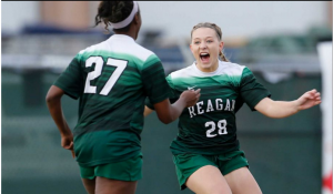 Reagan's Taylor Olson (28) reacts after scoring an early goal against Johnson in girls soccer at Blossom Soccer Stadium on Feb. 5, 2016. Johnson defeated Reagan, 2-1.