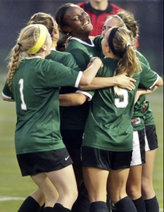Rattler teammates congratulate Tia Pearcy on her goal which proved to be the winning score as the Reagan girls beat Smithson Valley 1-0 in third round 6A soccer playoffs at the UTSA Park West Complex on April 7, 2015.