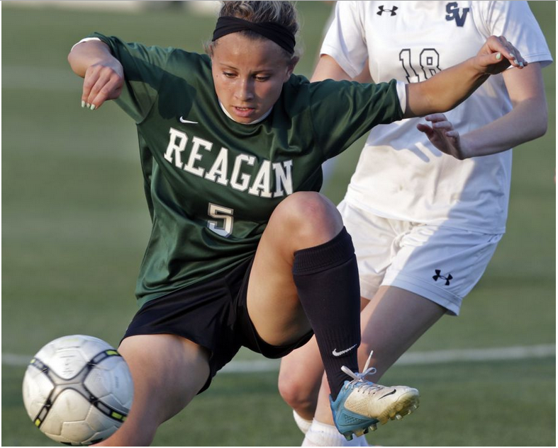 Reagan's Sam Batley works the ball against Smithson Valley. The Rattlers won 1-0 in a third-round 6A soccer playoff game at the UTSA Park West Complex on April 7, 2015.