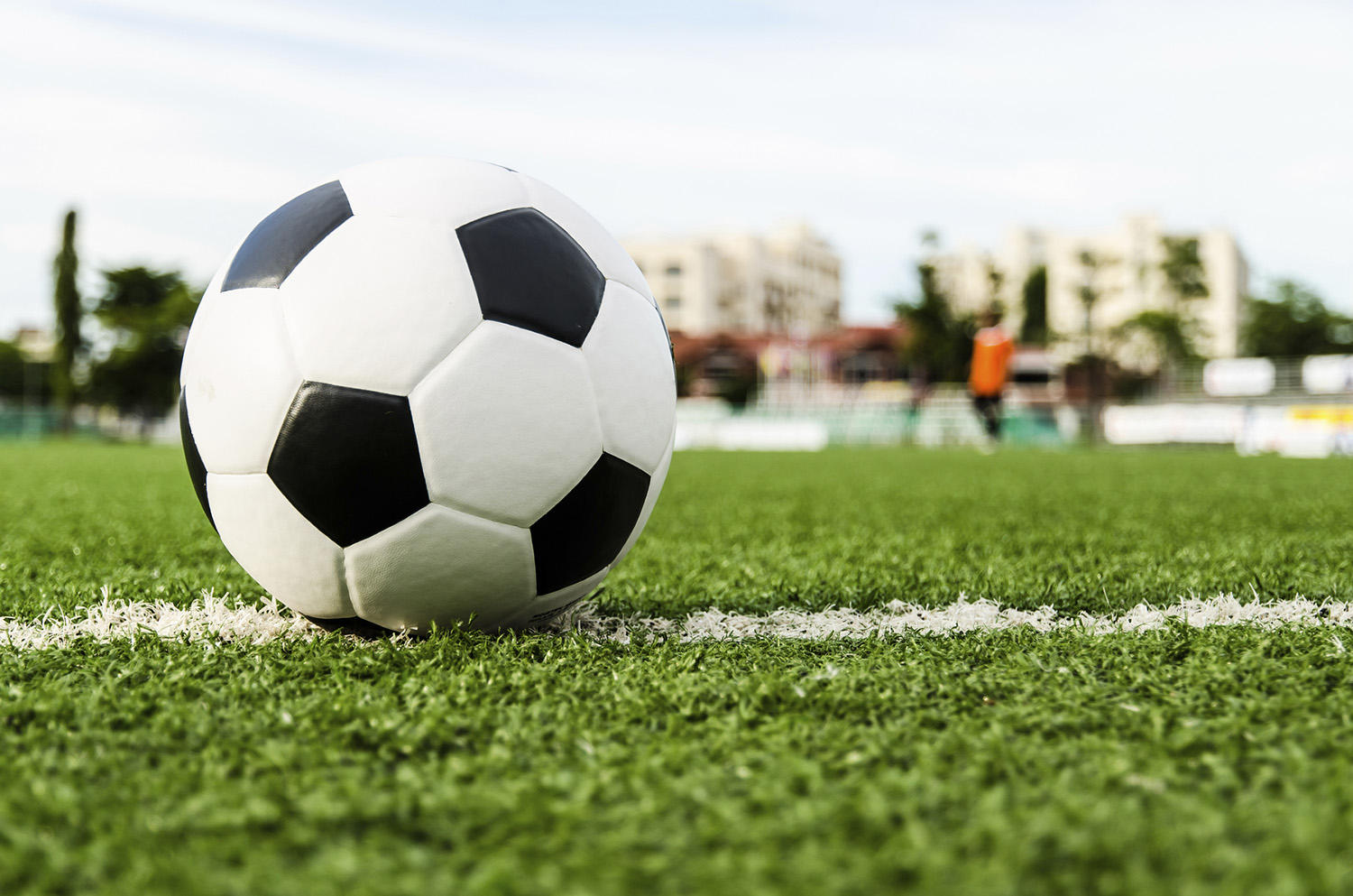 Image of Soccer ball on the green grass of Soccer field.